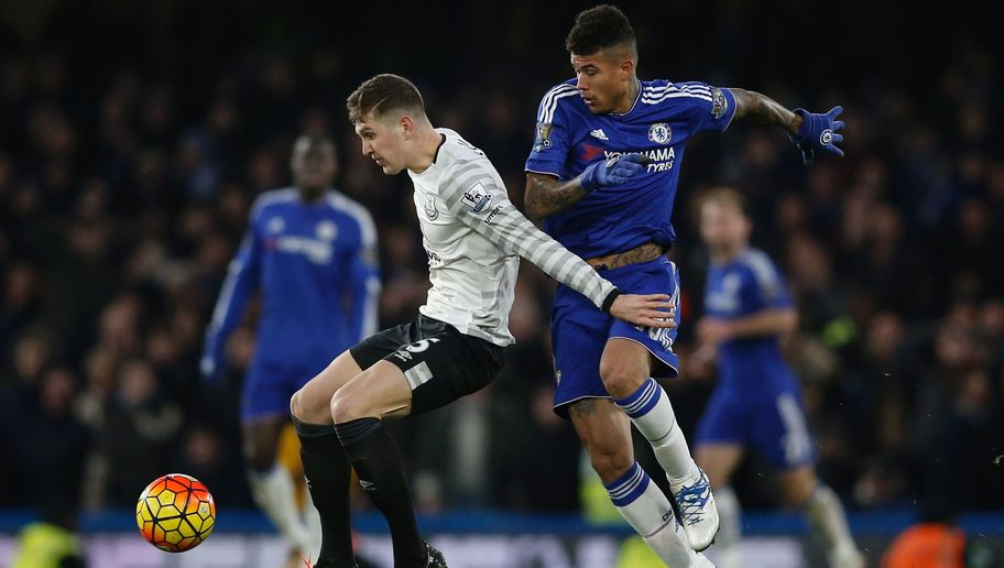 Everton's English defender John Stones (L) tries to hold off Chelsea's Brazilian striker Kenedy (R) during the English Premier League football match between Chelsea and Everton at Stamford Bridge in London on January 16, 2016. AFP PHOTO / ADRIAN DENNIS RESTRICTED TO EDITORIAL USE. No use with unauthorized audio, video, data, fixture lists, club/league logos or 'live' services. Online in-match use limited to 75 images, no video emulation. No use in betting, games or single club/league/player publications. / AFP / ADRIAN DENNIS        (Photo credit should read ADRIAN DENNIS/AFP/Getty Images)